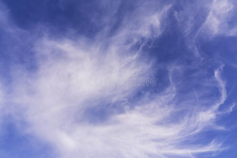 Beautiful white Cirrus clouds on a blue sky royalty free stock photo