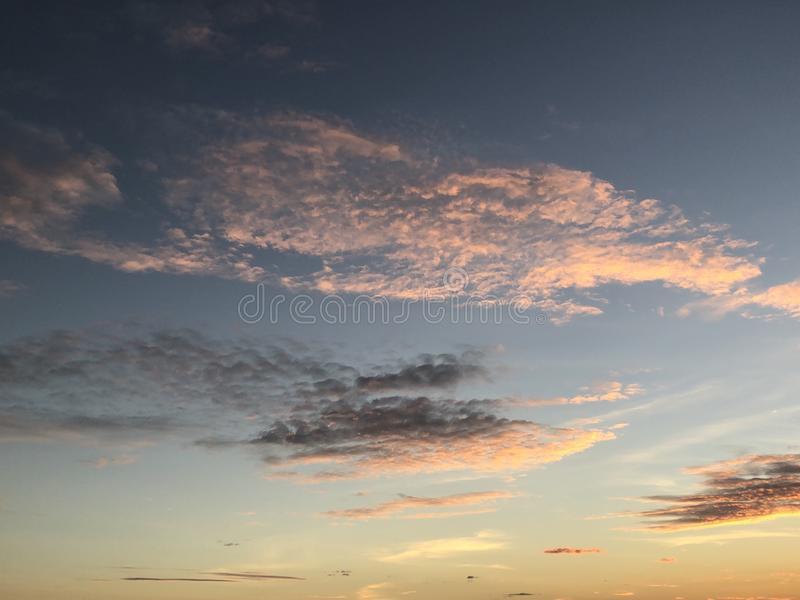Cloud in the blue sky at the sunset. Beautiful white cloud in the amazing sky at the sunset royalty free stock photo