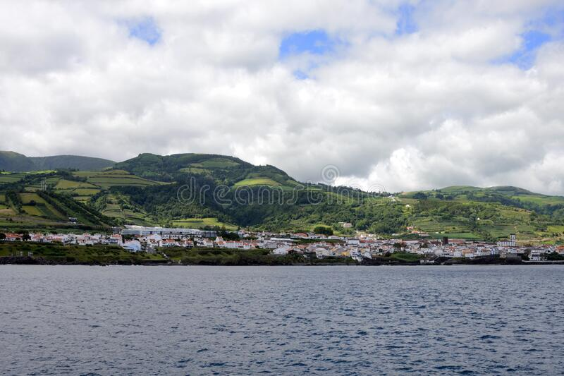 Beautiful white clouds on the blue sky and coast of the city of Ponta Delgada, San Miguel Island, Portugal.  royalty free stock images