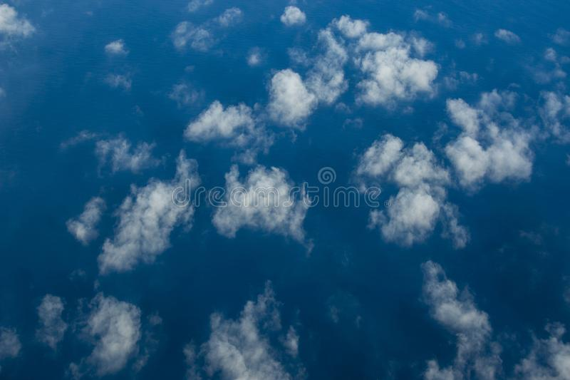 Beautiful clouds over the sea. Beautiful white clouds forming and moving in blue sky royalty free stock photos