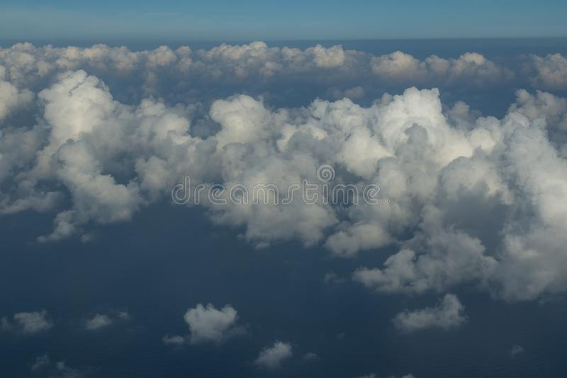Beautiful clouds over the sea. Beautiful white clouds forming and moving in blue sky stock images