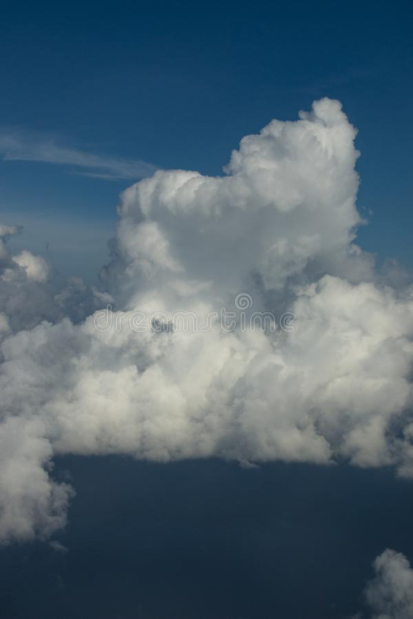 Beautiful clouds over the sea. Beautiful white clouds forming and moving in blue sky stock image