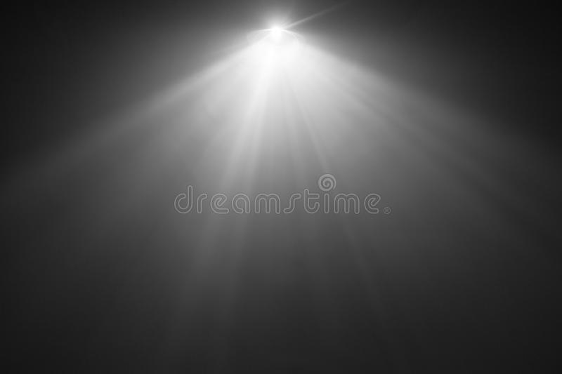 White color wide lens . smoke texture spotlight . screening for multimedia . abstract. Beautiful white color wide lens projector with light beam for movie and stock image