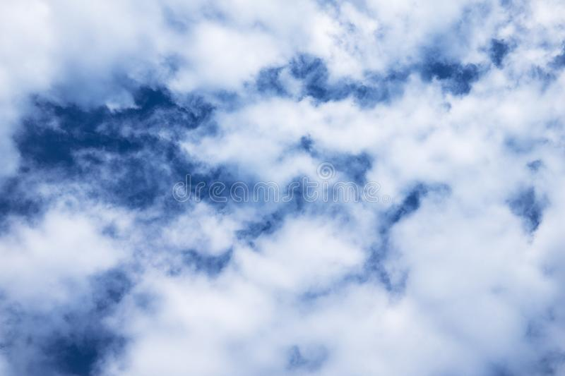 Beautiful white cumulus clouds against blue sky. royalty free stock images