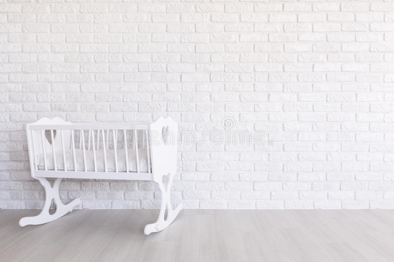 Beautiful white design. Shot of a white modern nursery with a crib stock photography