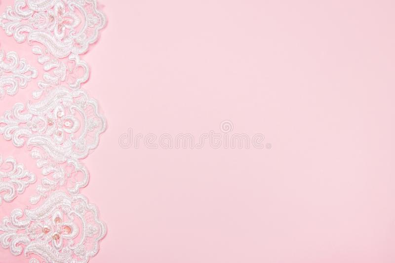 Beautiful white floral lace on a pink background.  royalty free stock images