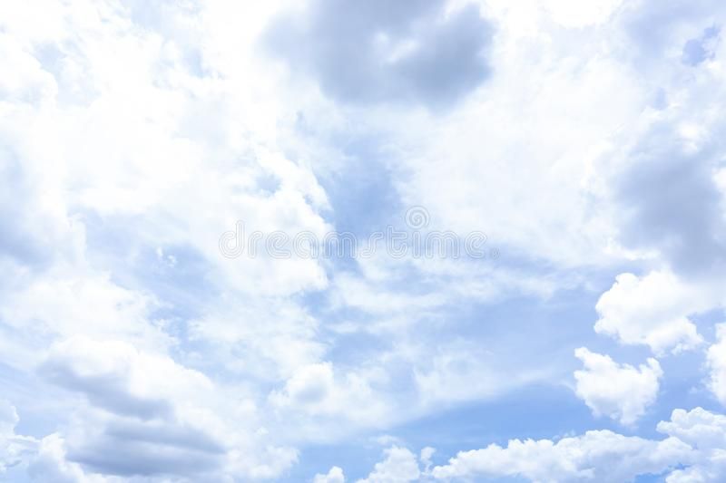 Beautiful white fluffy cloud formation on vivid blue sky in a sunny day. Beautiful white fluffy clouds formation on vivid blue sky know as raincloud royalty free stock image