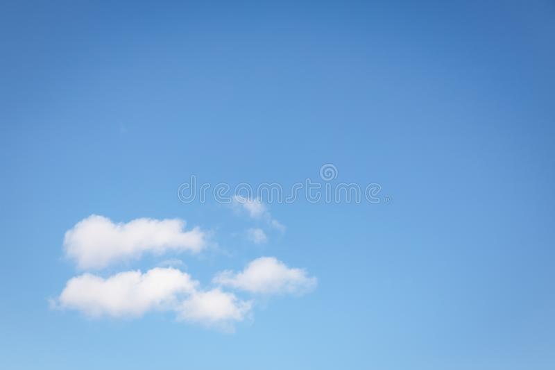 Beautiful white fluffy clouds on a clear blue sky background. Copy space stock photos