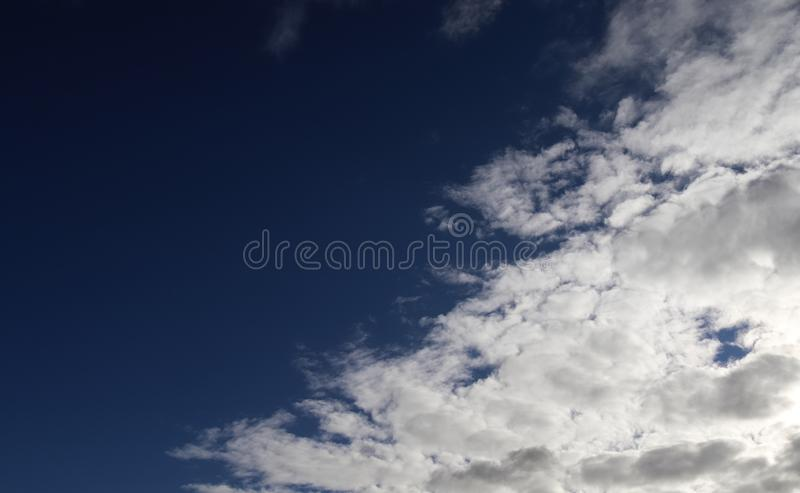 Colorful coral at the white sand beach on the SeychellesBeautiful white fluffy clouds on a deep blue sky royalty free stock photos