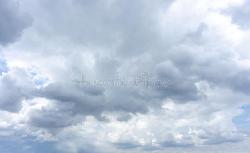 Beautiful white fluffy clouds formation on vivid blue sky know as raincloud. Beautiful white fluffy clouds formation on vivid blue sky know as rain cloud royalty free stock photography