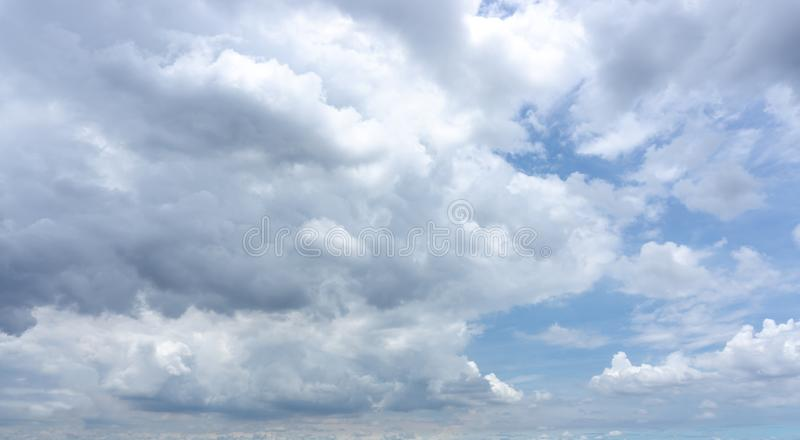 Beautiful white fluffy clouds formation on vivid blue sky know as raincloud. Beautiful white fluffy clouds formation on vivid blue sky know as rain cloudy stock photos