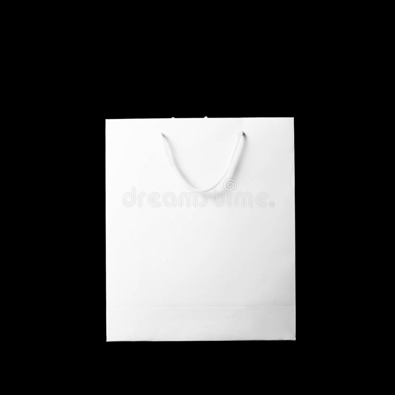 Beautiful white gift bag. Close up. Isolated on black background.  stock photos