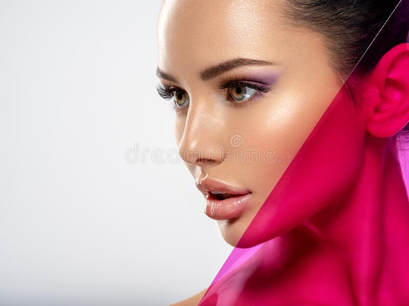 Beautiful white girl with bright eye-makeup. Beautiful fashion woman with  a colored  items.   Glamour fashion model with bright royalty free stock photography
