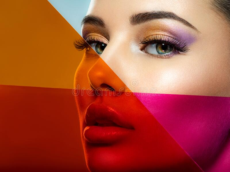 Beautiful white girl with bright eye-makeup. Beautiful fashion woman with  a colored  items.   Glamour fashion model with bright stock photo