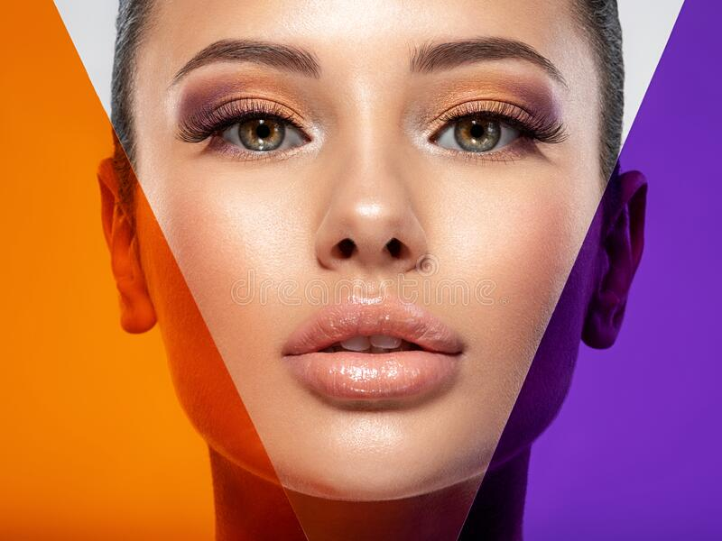 Beautiful white girl with bright eye-makeup. Beautiful fashion woman with  a colored  items.   Glamour fashion model with bright stock image