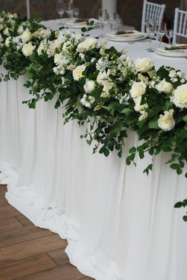 Beautiful White and Green Flower Decoration Arrangement on Wedding Table. Wedding Bridal Flower Decoration. stock photo
