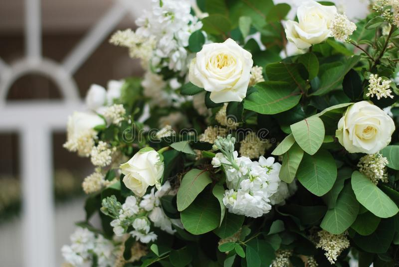 Beautiful White and Green Flower Decoration Arrangement on Wedding Table Golden Support . Wedding Bridal Flower Decoration. Beautiful White and Green Flower royalty free stock photography
