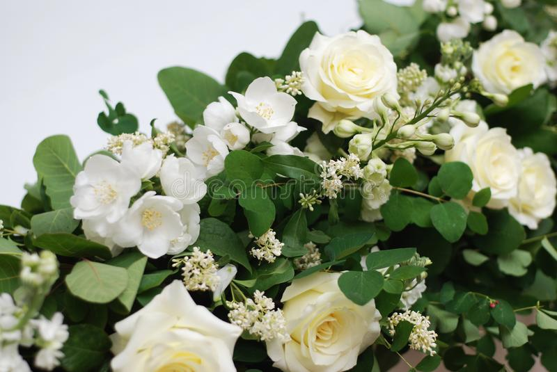 Beautiful White and Green Flower Decoration Arrangement on Wedding Table Golden Support . Wedding Bridal Flower Decoration. royalty free stock photos