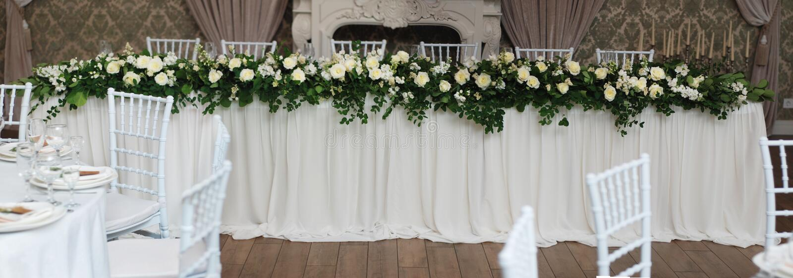 Beautiful White and Green Flower Decoration Arrangement on Wedding Table. Wedding Bridal Flower Decoration. Banner. Beautiful White and Green Flower Decoration royalty free stock images