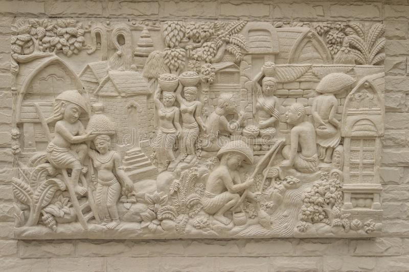 Beautiful white Java stucco patterned on the boundary wall. Vintage white wall bas-relief stucco in plaster, depicts Lotus flower royalty free stock image