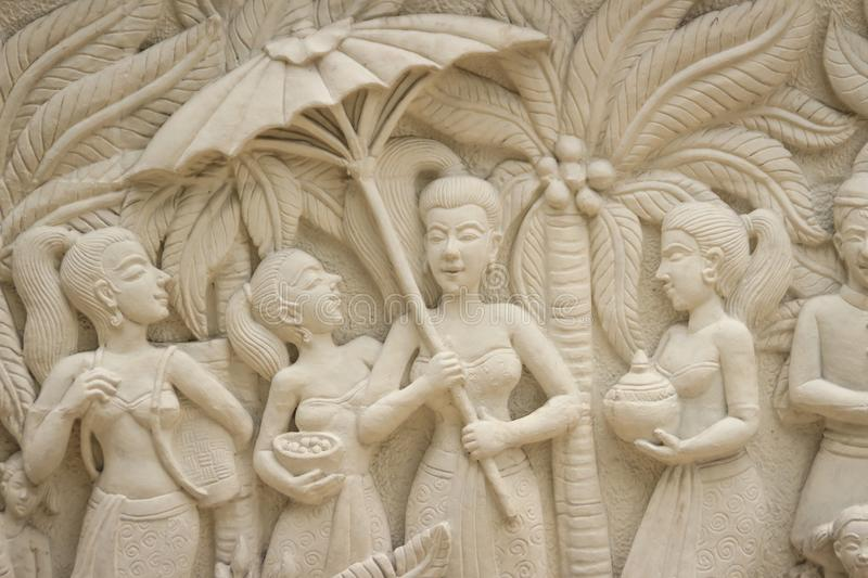 Beautiful white Java stucco patterned on the boundary wall. Vintage white wall bas-relief stucco in plaster, depicts Lotus flower stock images