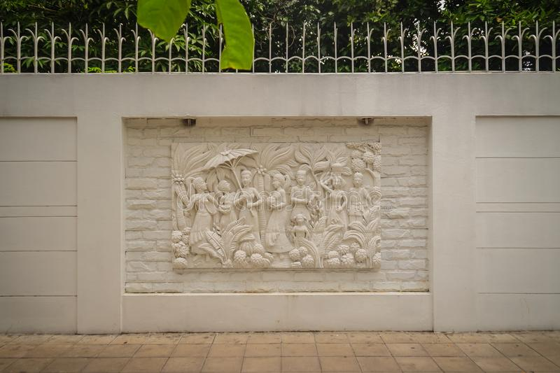 Beautiful white Java stucco patterned on the boundary wall. Vintage white wall bas-relief stucco in plaster, depicts Lotus flower royalty free stock images