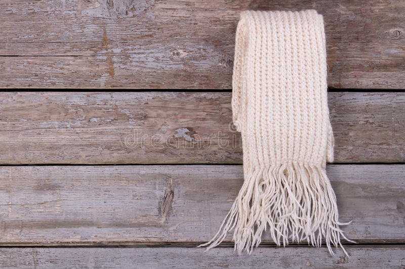 Beautiful white knitted scarf. royalty free stock images