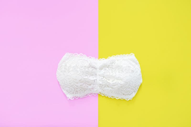 Beautiful White Lace Underwear Isolated on Yellow and Pink Color Pastel for Valentine is Day. Set of Accessory Lingerie Bikini. Fabric. Woman is Lace Bra stock photo