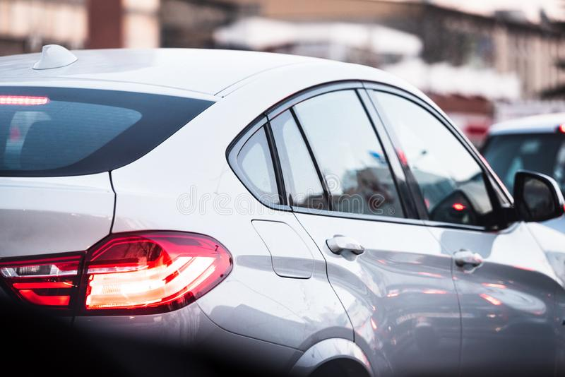 Beautiful white luxury car stuck in traffic stock photos