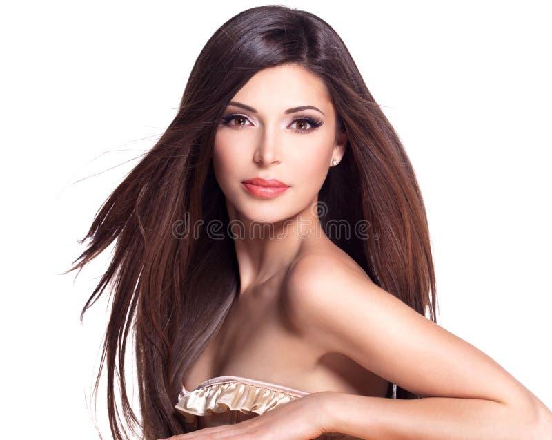 Beautiful white pretty woman with long straight hair. Portrait of a beautiful white pretty woman with long straight hair royalty free stock image