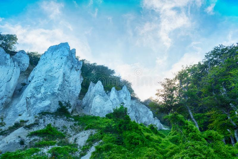 Beautiful white rocks on a background of blue cloudy sky. Mountain landscape stock photography