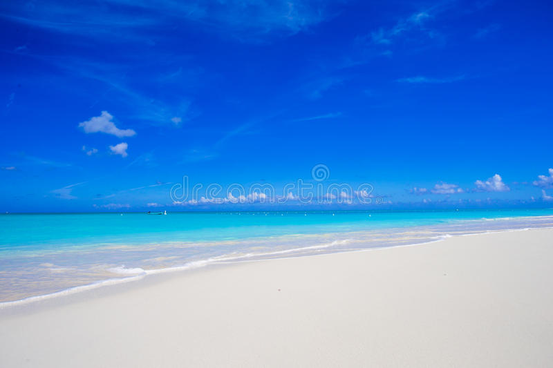 Beautiful white sand beach and turquoise clean water on tropical exotic island stock photos