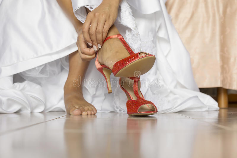 Beautiful white shoes from bride stock photography