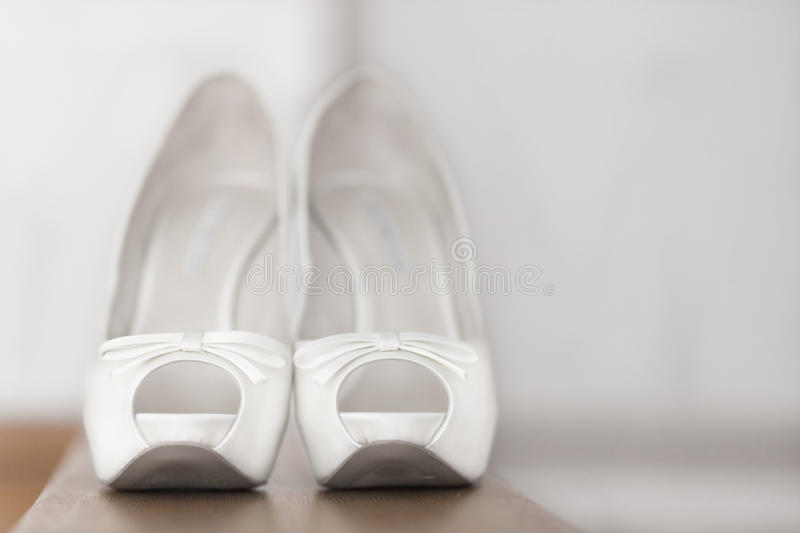 Beautiful white shoes from bride royalty free stock photos