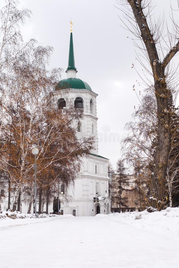 Beautiful white snowy path in the cold and winter leading to a church. royalty free stock photo