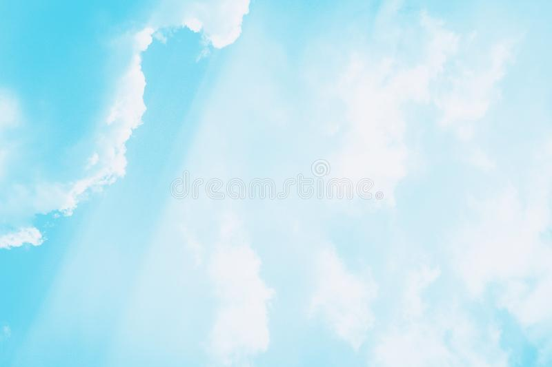 Beautiful white soft fluffy clouds on a sky background. Sunlight, light and shadow. Blue turquoise toned stock photos
