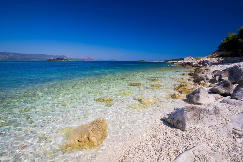Beautiful white stone beach royalty free stock photos