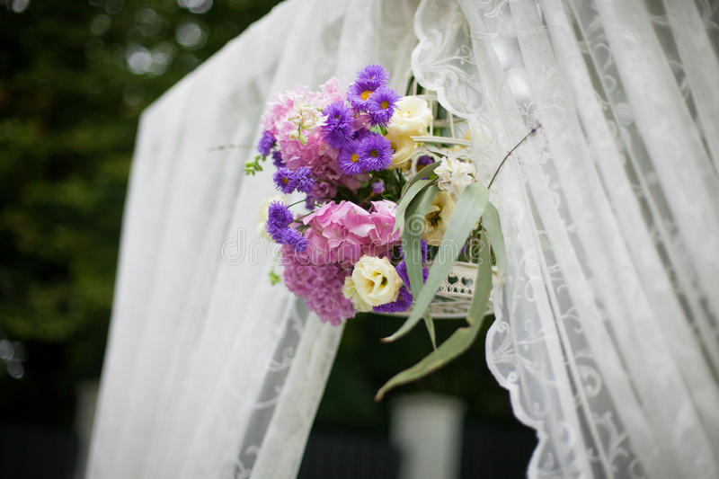 Beautiful White Wedding Aisle Archway With Purple Flowers
