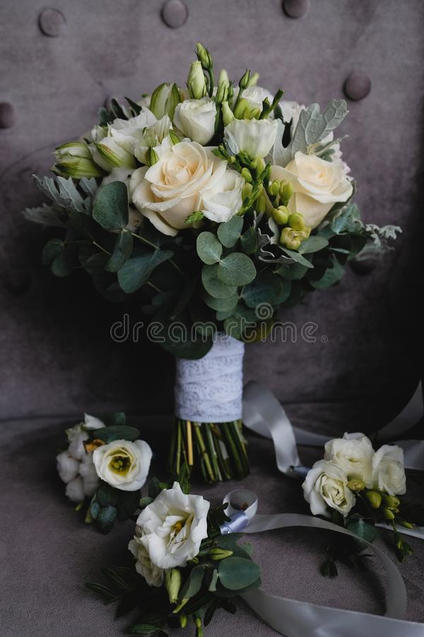 Beautiful white wedding bouquet and boutonnieres for bridesmaids stock images