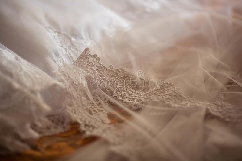 Beautiful white wedding veil with lace royalty free stock photography