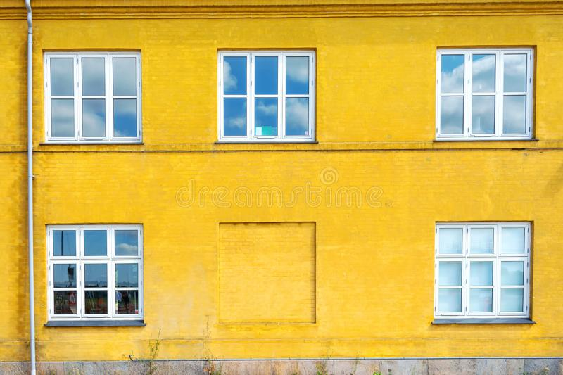 Beautiful white wooden windows on a yellow brick wall. Architecture. Details stock photos