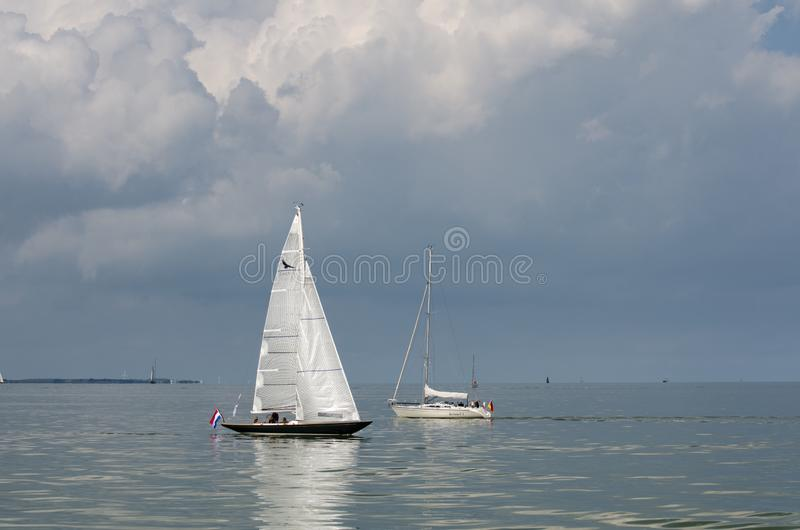 Beautiful white yacht sailing at IJsselmeer bay. Netherlands royalty free stock photography