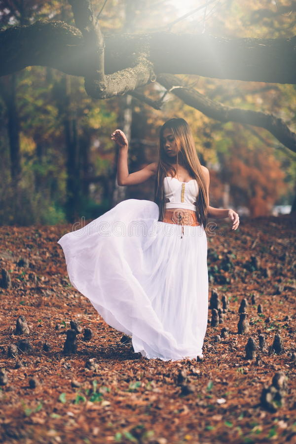 Beautiful wiccan girl dancing in the mystical forest royalty free stock photos