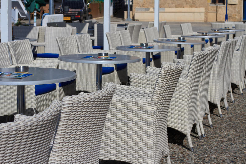 Beautiful wicker furniture in a street cafe royalty free stock image