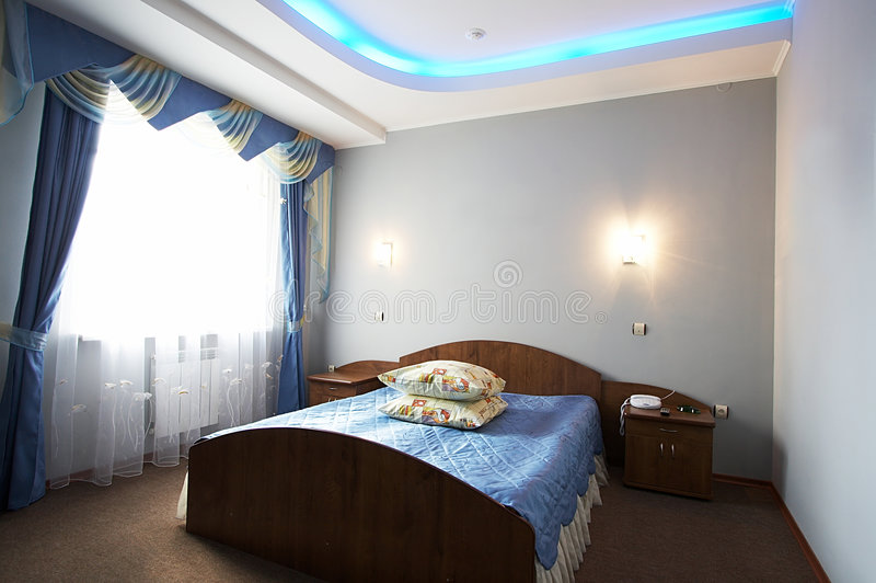 Beautiful and wide bed. In modern hotel stock images