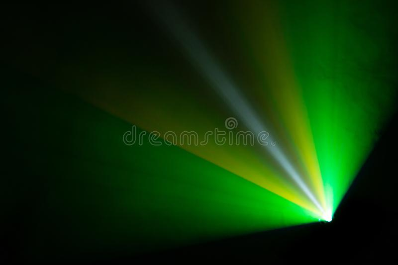 Beautiful wide lens light beam for movie and cinema at night . smoke texture spotlight . laser glowing rays stock photography