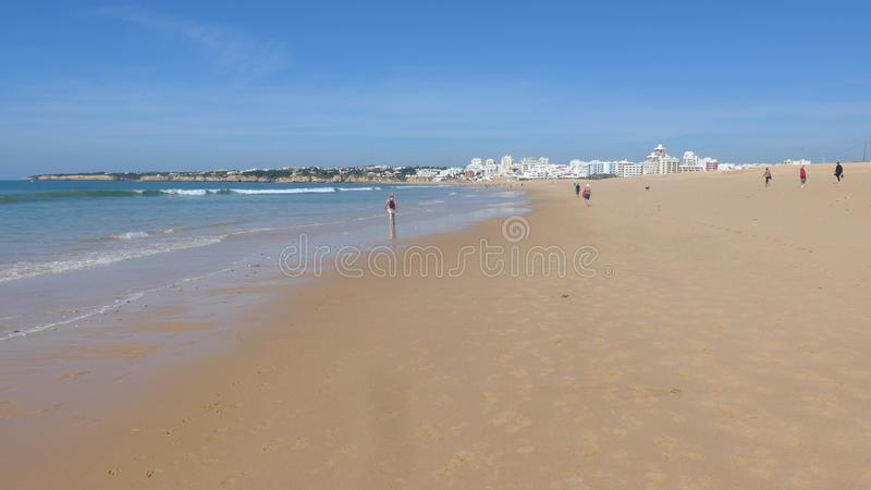 Beautiful, wide sandy beach on the Atlantic Ocean at low tide, Armacao de Pera, Silves, Algarve, Portugal. Beautiful, wide sandy beach on the Atlantic Ocean at stock photography