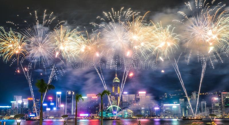 Beautiful wide shot of breathtaking fireworks in the night sky during holidays over the city stock photo