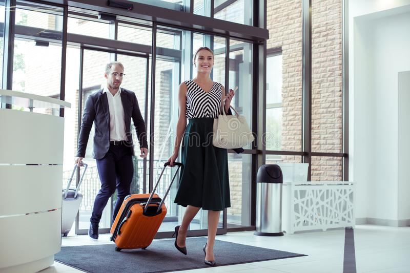 Beautiful wife accompanying her successful husband on business trip stock image