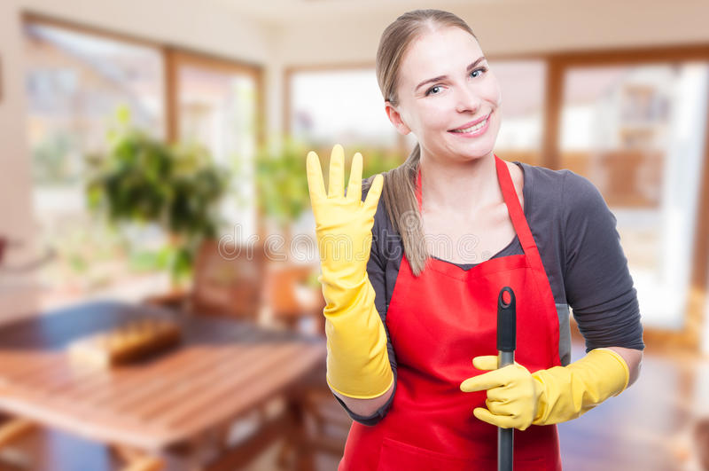 Beautiful wife cleaning the house cheerfully royalty free stock images